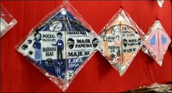 પતંગો થકી લોકો સુધી કોરોના અંગેની જાગૃતિના સંદેશ પહોંચાડવાની કામગીરીઃ આ વર્ષે બજારમાં કોરોનાને લગતા પતંગો દેખાયા
